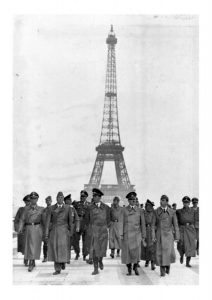 Hitler and the Nazis in front of the Eiffel Tower.