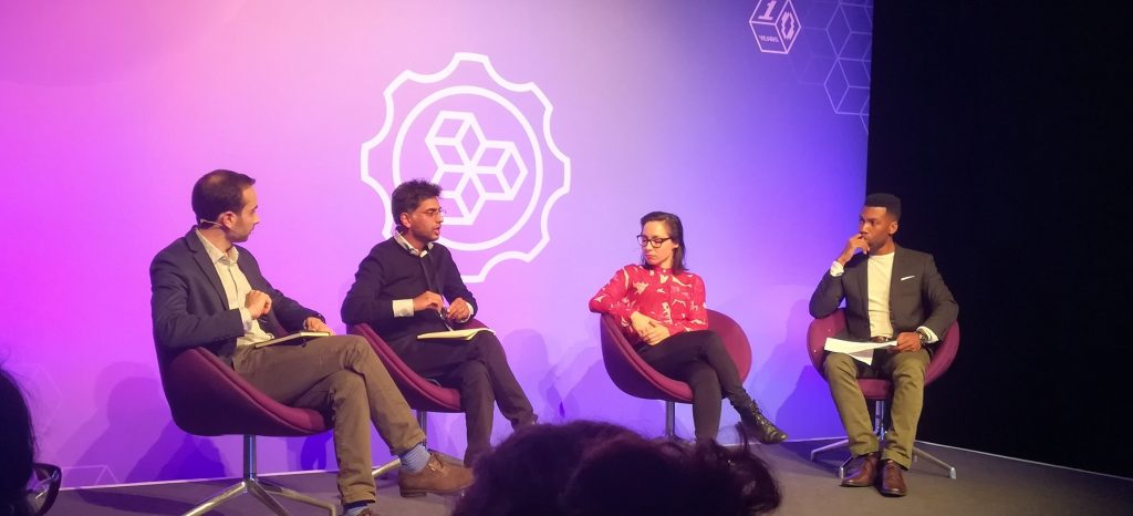 Four people talking on a stage at MozFest